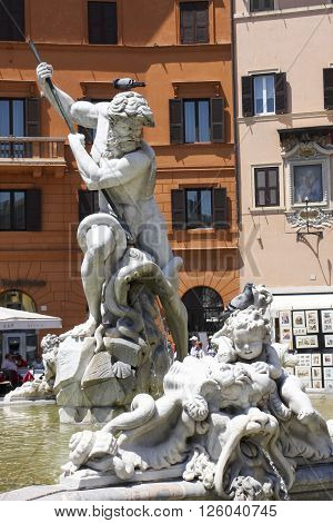 ROME, ITALY - JUNE 3, 2012: The fountain of Neptune on Piazza Navona was originally called the fountain of the kettle makers remained unfinished for a long time until a few marine deities were added along with the statue of the god of the sea.