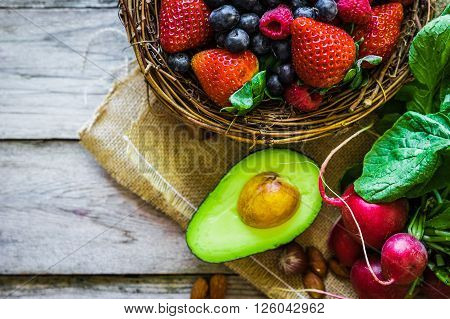 Image of Fruits and vegetables on rustic background