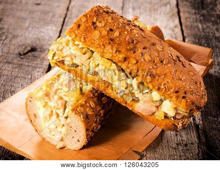 Gourment sandwiches with gourment salad on rustic background