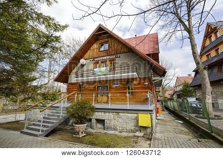 ZAKOPANE POLAND - MARCH 09 2016: Holiday House called Sienkiewiczowka 2 building with elements of Zakopane style offers accomodation for tourists coming to town