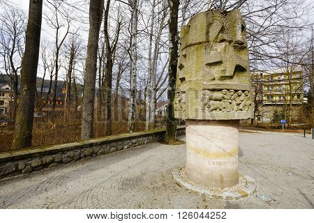 ZAKOPANE POLAND - MARCH 06 2016: Monument to Mountain Rescuers is made of stone appear scenes of mountain rescuers in action. It is the work of Hasior sculptor and painter and was unveiled in 1959