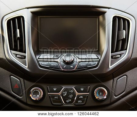 The modern car dashboard. Screen multimedia system.