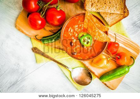 Hot And Spicy Fresh Made Mexican Chili Soup On Rustic Background