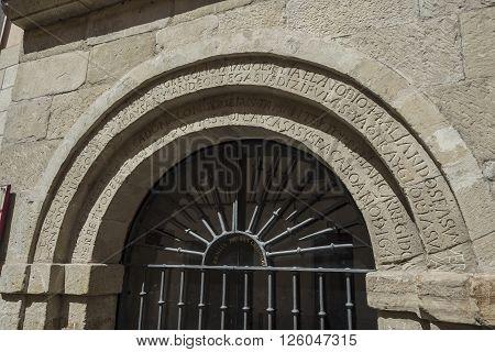Latin inscription detail in the arch of Ermita de San Gregorio hermitage (Bishop of Ostia). Landmark for pilgrims on the road to Santiago de Compostela Way of Saint James. Logroño La Rioja. Spain.