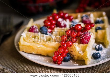 Image of affles with berries on rustic background