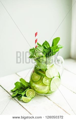 Water With Limes And Mint On Wooden Background