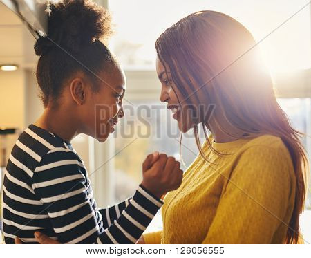 Mom and daughter black smiling and loving