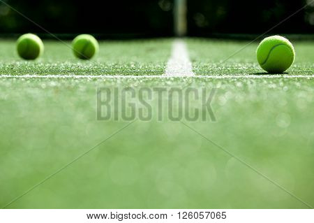soft focus of tennis ball on tennis grass court