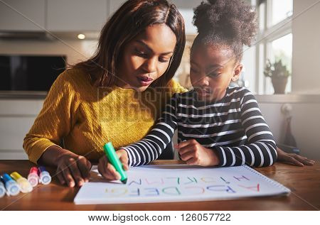 Black Mother And Child Doing Homework