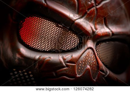 Steel mask covered with rust closeup photo