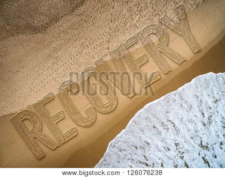 Recovery written on the beach