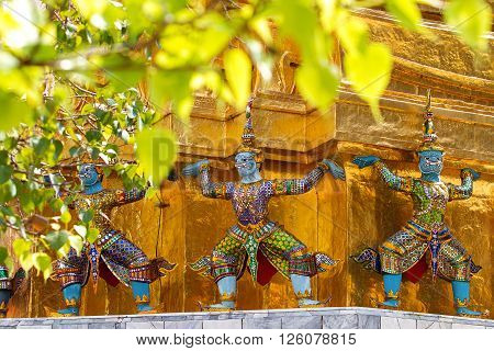 Sculpture in Royal Palace Bangkok Thailand. Wat Phra Keo. Architecture detail - statue of mythical creature with blue skin.