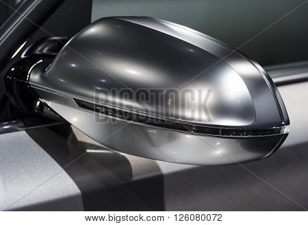Rear view mirror on side of concept modern sport racing silver car