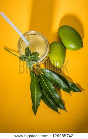 Aam Panna or Salted Green Mano Juice or green kairi panha or kairi pahna, refreshing cold dring in indian summer, over yellow background poster