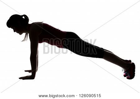 Silhouette of sporty woman doing bar on white background