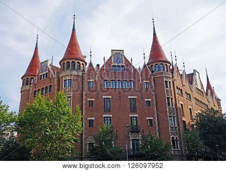 BARCELONA, SPAIN - AUGUST 1, 2015: Casa de les Punxes (House of Spikes) is built in the shape of medieval castle - one of the most recognizable modernist landmarks designed by Josep Puig i Cadafalch