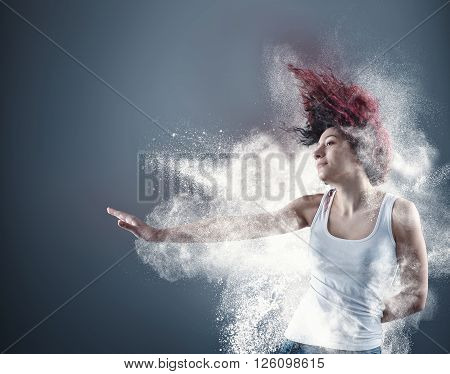 Young girl poses surrounded by explosive powder.