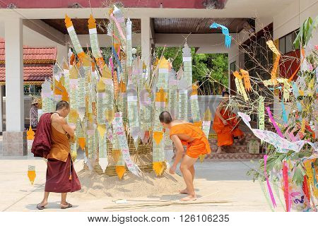 Lampang, THAILAND-APRIL 15, 2016 : Songkran Festival is celebrated in a traditional New Year's Day, Monks comes to decorate tung in the temple in Wat Luang, Ngao, Lampang, Thailand. North of Thailand.
