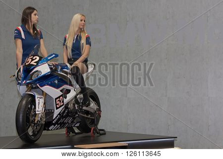 BRNO, CZECH REPUBLIC-MARCH 4,2016: Beautiful hostesses present motorcycle BMW S 1000 RR on International Fair for Motorcycles on March 4,2016 in Brno in Czech Republic