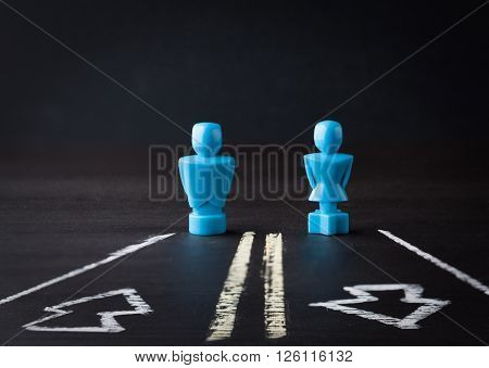 Male And Female Figurines On Two Way Road