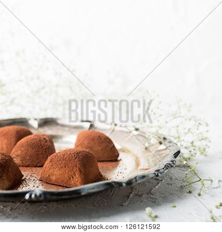 Handmade candies Tiramisu in eart shape. Valentine's Day and Mother's Day concept.