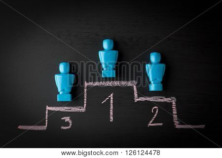 Competition leadership sportsmanship and winning concept depicted with male figurines