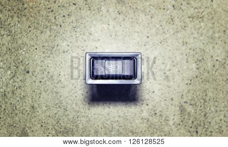Incorporating fog lamps button on a gray background