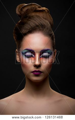 Beauty closeup portrait of young girl with makeup on black