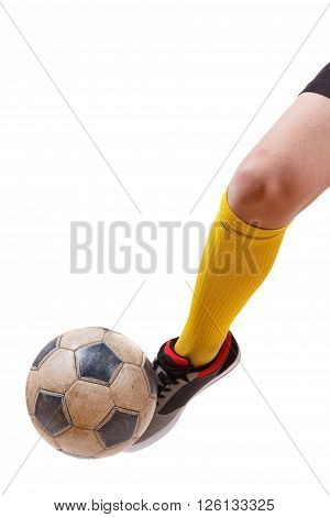 Soccer ball on the foot of a caucasian football player. Hitting the ball.. Isolated on white background