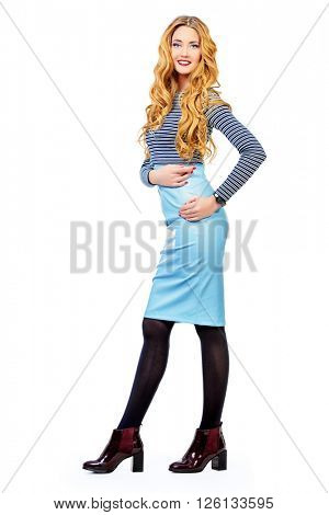 Vogue shot of a beautiful elegant young woman in over white background. Business style clothes. Full length portrait.