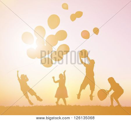 Children Outdoors Playing with Balloons Concept