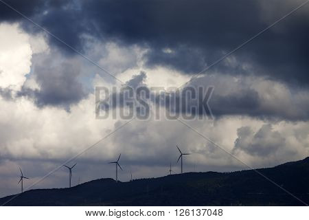 Wind Farm And Cloudy Sky Before Storm