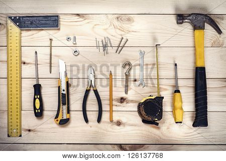 group tools on wooden background