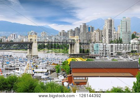 Burrard bridge yachts and boats by Granville island public market. Canada.