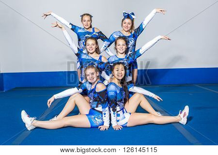 A Portrait of beautiful cheerleaders  in action