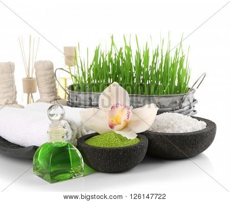 Spa treatment with essential oils and salt isolated on white.
