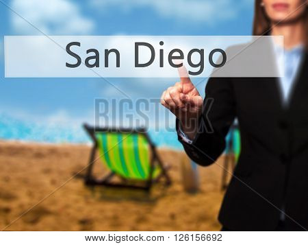 San Diego - Businesswoman Hand Pressing Button On Touch Screen Interface.