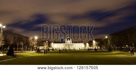 PARIS, FRANCE - MARCH 28, 2016: Beautiful view of Ecole Militaire (Military School) and Champ de Mars park at dusk. UNESCO World Heritage Site