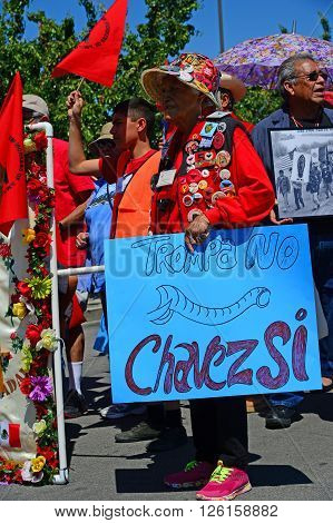 DELANO, CA - APRIL 17, 2016: An unidentified woman, a long-time UFW member, joins the Cesar Chavez march for immigrants' and agricultural workers' rights.