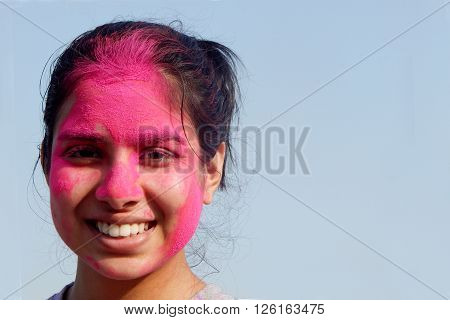 HYDERABAD,INDIA-MARCH 20:Portrait of a Hindu woman celebrating Holi festival smearing colored powder a tradition on March 20,2016 in Hyderabad,India