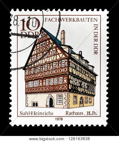 GERMAN DEMOCRATIC REPUBLIC - CIRCA 1978 : Cancelled postage stamp printed by German Democratic Republic, that shows  City Hall in Suhl Heinrichs.