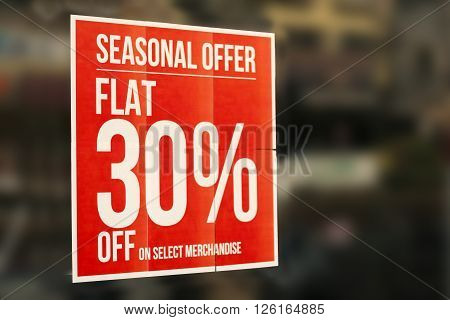 Closeup photo of Discount sale sign in front of retail clothes store