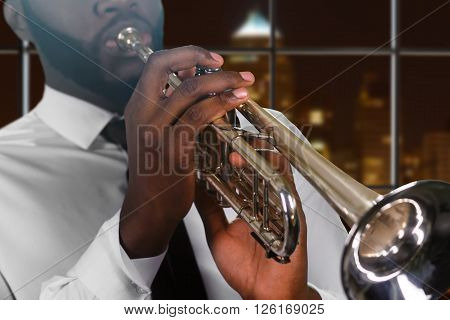 Afro man's hand on trumpet. Young trumpeter in night megalopolis. Composer's inspiring music. Skillful blues performer.