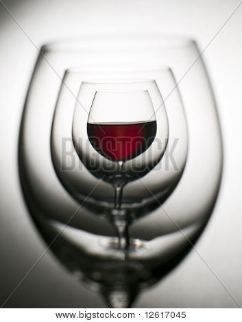 Glass of red wine close up abstract shoot poster
