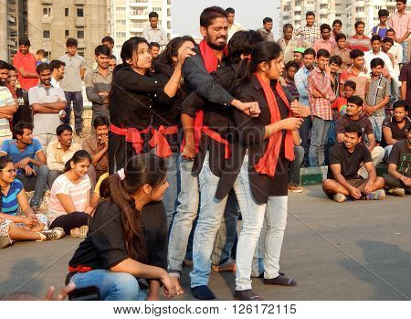 HYDERABAD,INDIA-MARCH 27:Nishumbita theatre group perform street play theme of Driving safe on road during raahgiri open road event on March 27,2016 in Hyderabad,India