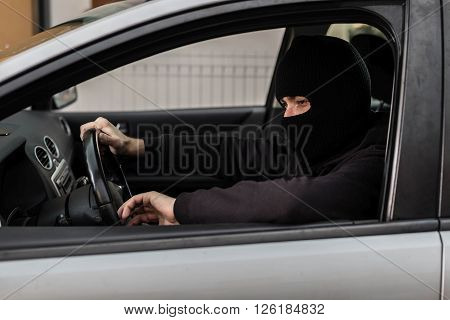 Car Thief Driving A Stolen Car.