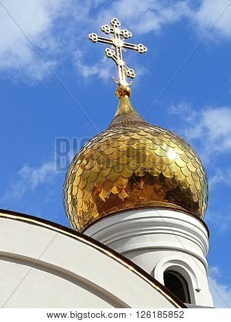 Church - a high dome and cross and nature
