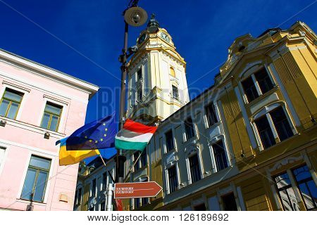 Pecs Hungary and city hall with flags. City in Baranya county,