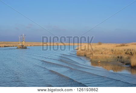 Crab Fishing Trawler near Greetsiel in Wadden Sea at North Sea,Lower saxony,Germany