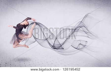 Modern ballet dancer performing with abstract swirl concept on background